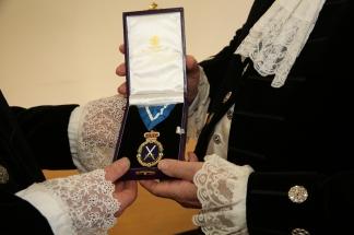 badge handover