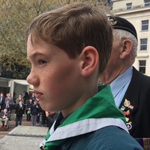 young scout ready to lay wreath