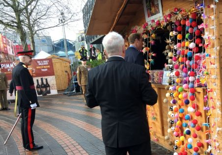 Vice Lord Lieutenant watches as an impromptu chat with German market stall holder
