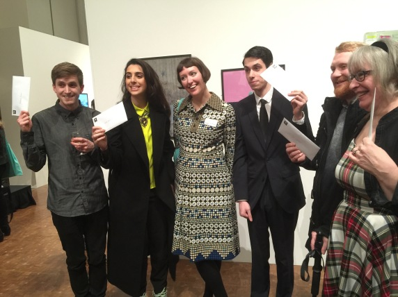 5 artists with their winning cheques